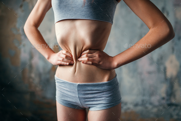 Female with slim waist, weight loss, anorexia - Stock Photo - Images
