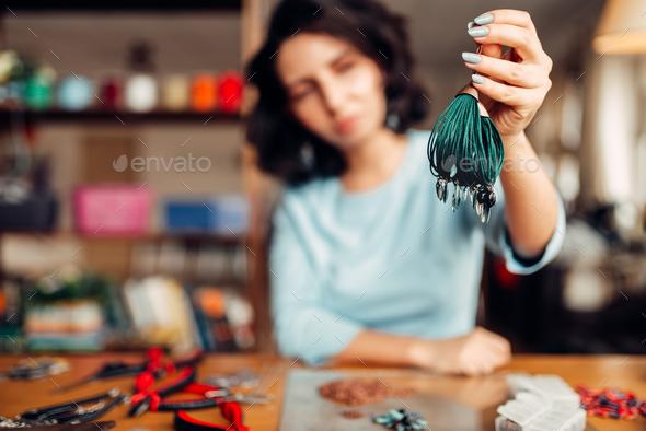 Woman shows handmade bracelet, needlework hobby - Stock Photo - Images