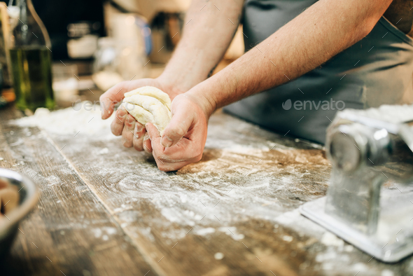Homemade pasta cooking, dough preparation on table - Stock Photo - Images