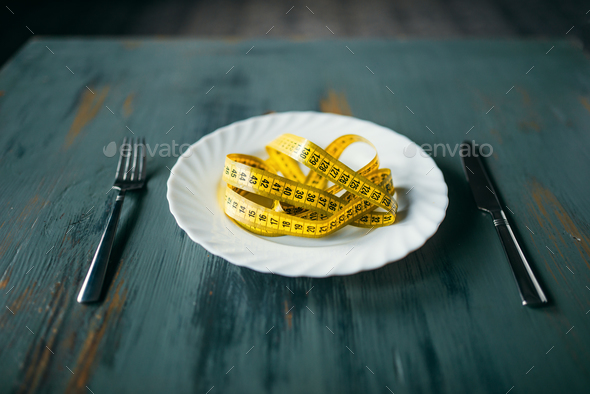 Plate with measuring tape closeup, fat burning - Stock Photo - Images