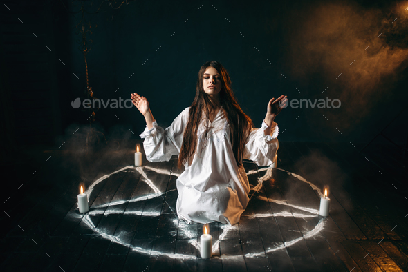 Witch in pentagram circle, evocation of spirits - Stock Photo - Images