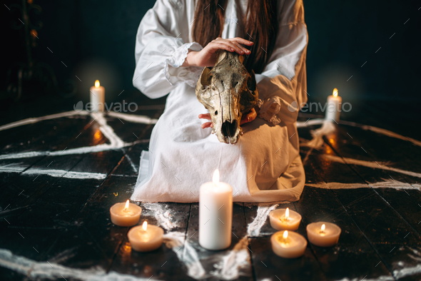 Female person holds skull in hands, magic ritual - Stock Photo - Images