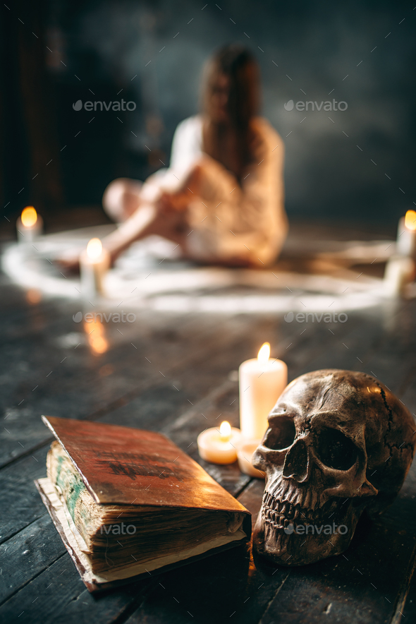 Human skull and spellbook,  occultism and exorcism - Stock Photo - Images