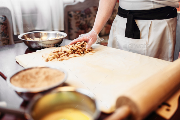 Chef cooking strudel, pastry ingredients - Stock Photo - Images