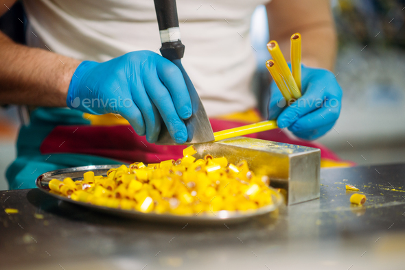Master hands in gloves, caramel making process - Stock Photo - Images