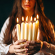 Female person holds candles in hands, divination - PhotoDune Item for Sale