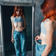 Thin woman tries on big size jeans, weight loss - PhotoDune Item for Sale