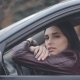 Sad Young Woman Sitting in a Car n the City Pensive Girl Waiting in the Car - VideoHive Item for Sale