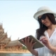 Young Woman Traveler Using Digital Tablet Computer Reading Guidebook App Searching Information - VideoHive Item for Sale