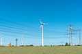 Wind engines and power supply lines on a sunny day - PhotoDune Item for Sale