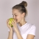 Attractive Young Girl Bites a Big Green Apple - VideoHive Item for Sale