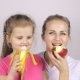 Beautiful Daughter and Mother Are Eating Fruits and Smiling - VideoHive Item for Sale