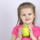 A Young Girl Is Holding a Big Green Apple - VideoHive Item for Sale