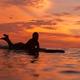 Surfer girl in ocean at sunset time - PhotoDune Item for Sale