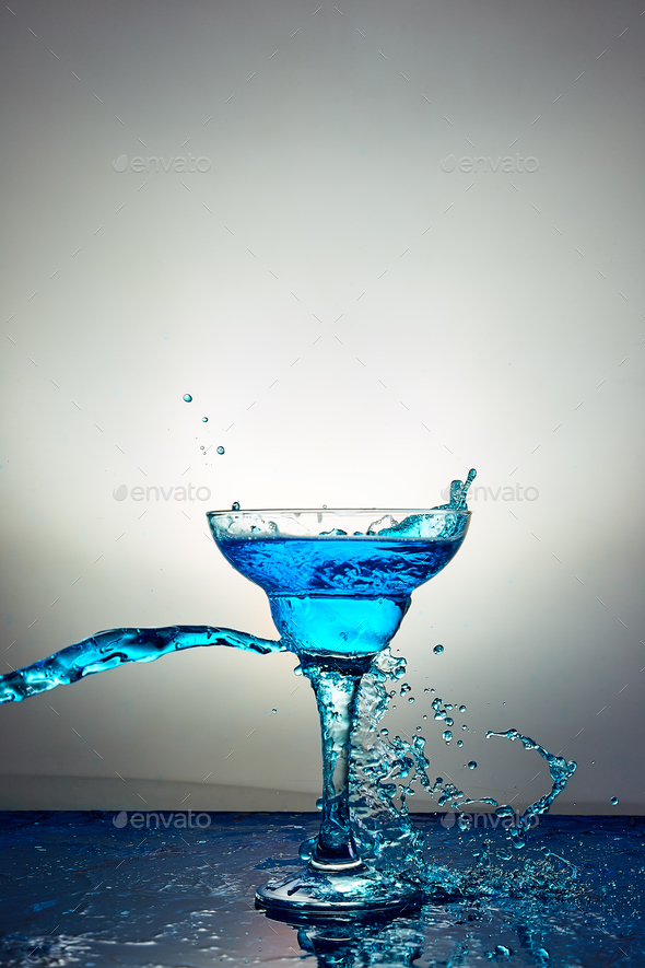 Glass with blue champagne or cocktail. Levitation - Stock Photo - Images