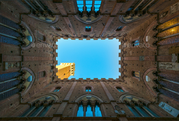 Siena landmark photo. Cortile del Podesta and Mangia tower. Tusc - Stock Photo - Images