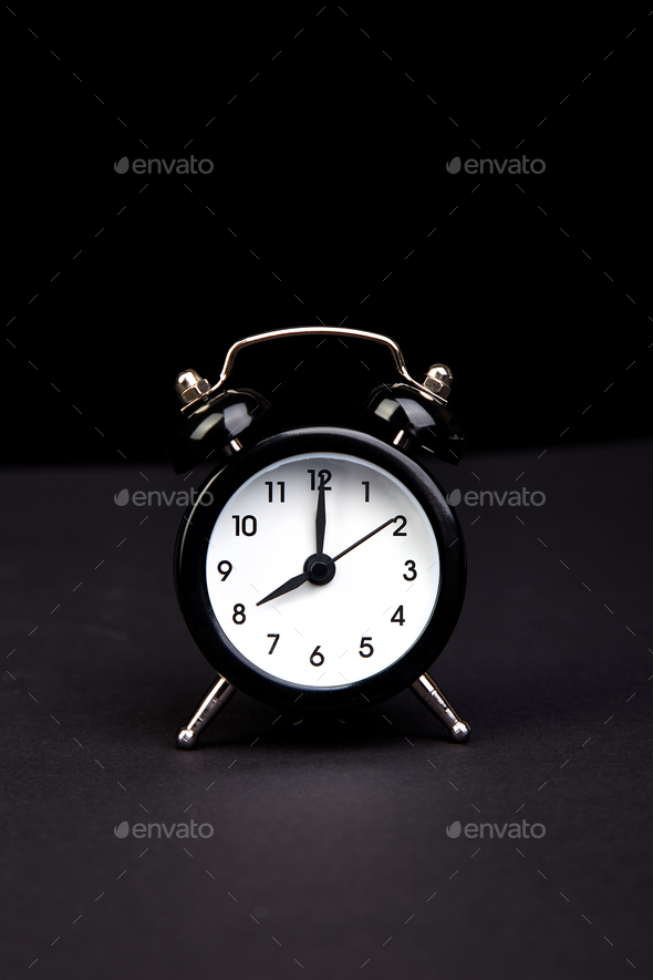 Black vintage alarm  clock. - Stock Photo - Images