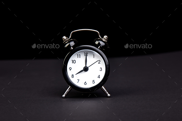 Black vintage alarm  clock. - Stock Photo - Images