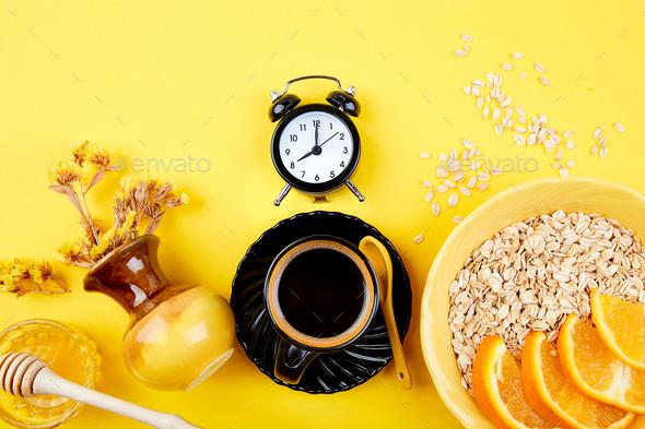 Morning coffee, granola breakfast, alarm clock - Stock Photo - Images