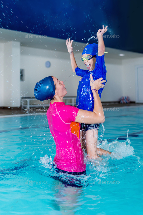 Swimming school. Cute little boy having fun with swimming instru - Stock Photo - Images