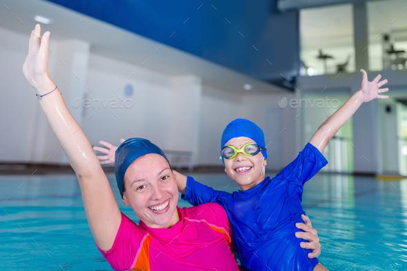 Swimming school. Cute little boy having fun with swimming instru - Stock Photo - Images