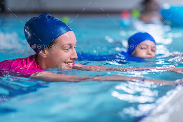 Swimming lesson. Cute little boy learning to swim with swimming - Stock Photo - Images