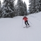 Sporty Woman Skis Professionally on a Slope of the Mountain Ski Resort - VideoHive Item for Sale