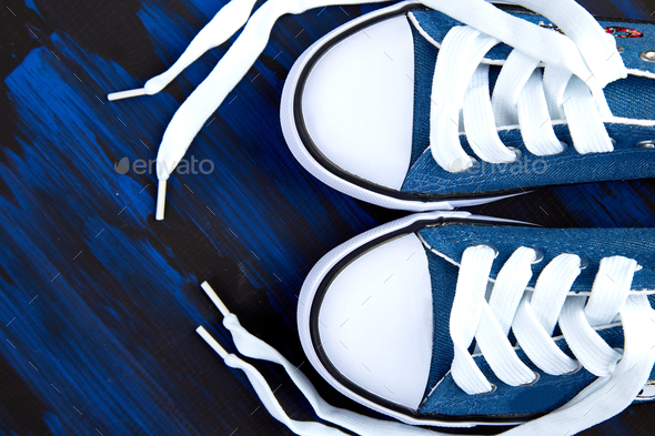Flat lay of female or male sneakers shoes - Stock Photo - Images