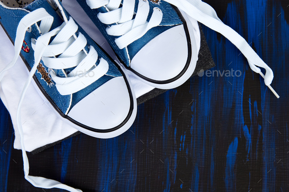 Flat lay of female sneakers shoes and tee - Stock Photo - Images