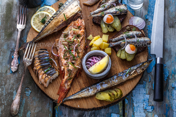 Fish plate with sturgeon, trout, perch, mackerel. Assorted fish on a plate - Stock Photo - Images