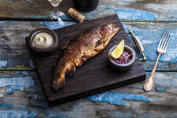 Smoked trout with spices on a stone tray. - Stock Photo - Images
