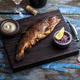 Smoked trout with spices on a stone tray. - PhotoDune Item for Sale