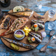 Smoked fish appetizers with mackerel, sturgeon, perch on woden cutting board - PhotoDune Item for Sale
