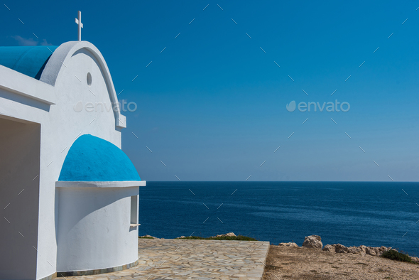Whitewashed church with blue roof near the sea. Agioi Anargyroi chapel, Cyprus - Stock Photo - Images