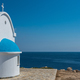Whitewashed church with blue roof near the sea. Agioi Anargyroi chapel, Cyprus - PhotoDune Item for Sale
