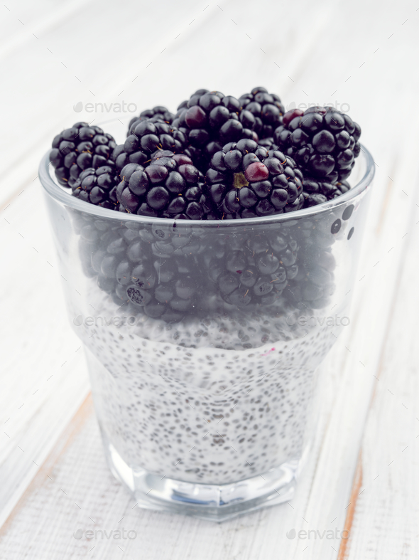 chia smoothie with berries on white wooden board - Stock Photo - Images