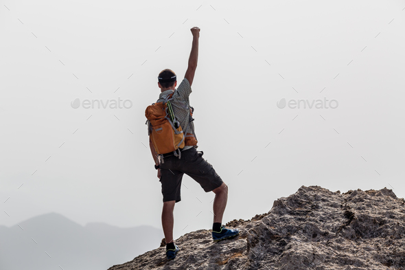 Happy winner reaching life goal success man - Stock Photo - Images