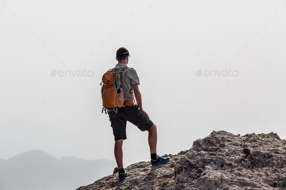 Man climbing hiking inspiration landscape, travel concept - Stock Photo - Images