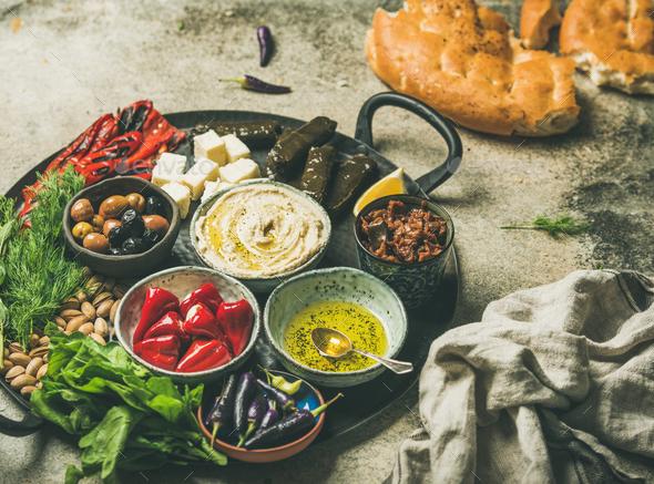 Mediterranean meze starter fingerfood platter in tray, selective focus - Stock Photo - Images
