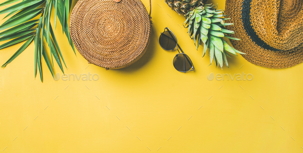 Colorful summer female fashion outfit over yellow background, wide composition - Stock Photo - Images