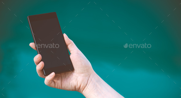 Female hand with mobile phone - Stock Photo - Images