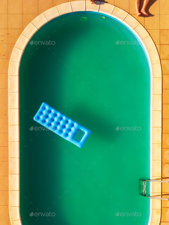 Aerial view of people relaxing by swimming pool - Stock Photo - Images