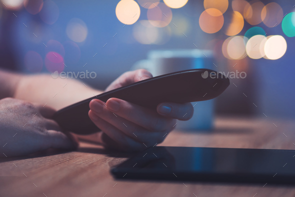 Female hand with television remote control - Stock Photo - Images