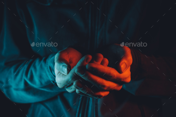 Empty cupped male hands pleading and begging - Stock Photo - Images