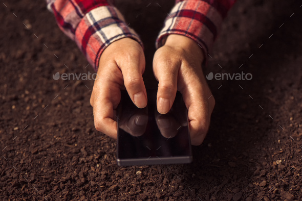 Farmer using smartphone - Stock Photo - Images