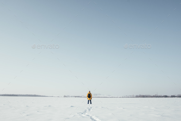 Alone traveler in yellow jacket - Stock Photo - Images