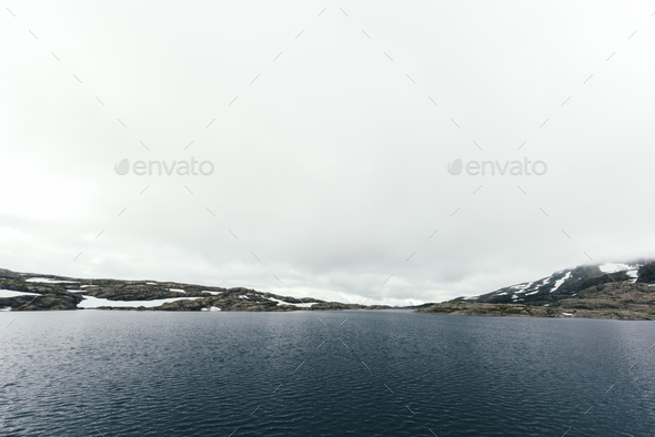 Typical norwegian landscape with clear lake - Stock Photo - Images