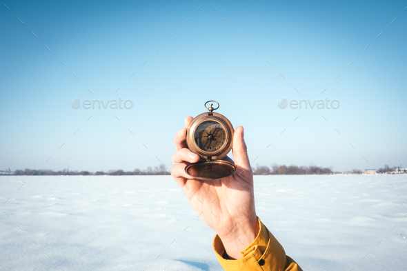 Man with compass in hand - Stock Photo - Images