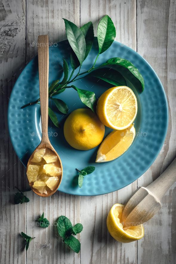 Lemon pieces on blue plate closeup - Stock Photo - Images