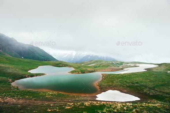 Koruldi lake Caucasus mountains on summer time - Stock Photo - Images